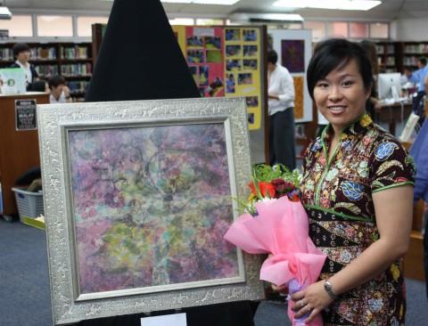 Emilia Tan and her batik painting